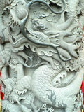 Dragon sculpture in stone. Dragon sculpture in grey stone Stock Image