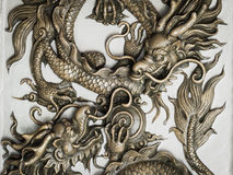 Dragon sculpture on wall royalty free stock image