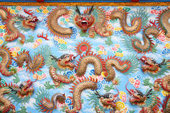 Dragon sculpture on wall in Chinese temple. Stock Photo