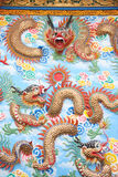 Dragon sculpture on wall in Chinese temple. Stock Photos