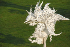 Dragon sculpture in White Temple Wat Rong Khun in Chiang Rai, Thailand Stock Photo