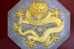Dragon sculpture on wood Royalty Free Stock Photo