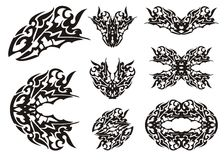 Dragon set in tribal style. Tattoos of the dragon head and dragon butterflies. Black on the white stock image