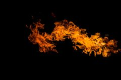 Dragon-shaped fire. Fire flames on black background. fire on black background isolated. fire patterns royalty free stock images