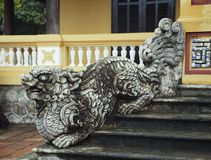 Dragon-shaped handrail in Hue Imperial Palace. Vietnam. The symbol of good fortune on the wall stock images