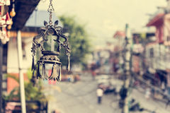 Dragon shapped candle holder hanging from a roof. Royalty Free Stock Photo