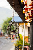 Dragon shapped candle holder hanging from a roof. Royalty Free Stock Photos