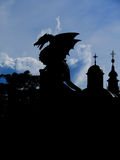 Dragon silhouette. Photo of dragon outlines with churches in background made in Ljubljana Slovenia , Dragon silhouette, dragon in the city , middle age , dragon Stock Photo