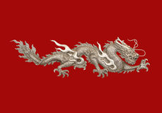 Dragon. Silver Dragon red backdrop. With clipping path royalty free stock photos