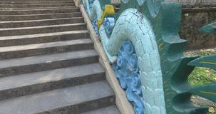 Dragon. Snake - dragon at the entrance in the chinese temple protecting temple from the evil spirits and ghosts stock video footage