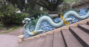 Dragon. Snake - dragon at the entrance in the chinese temple protecting temple from the evil spirits and ghosts stock video