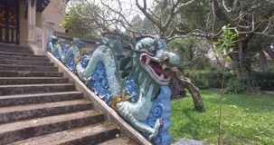Dragon. Snake - dragon at the entrance in the chinese temple protecting temple from the evil spirits and ghosts stock footage