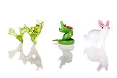 Dragon Snake and Rabbit. Small glass sculptures representing the chinese zodiac signs isolated over a pure white background stock photo