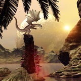 Dragon standing on a rock Royalty Free Stock Image