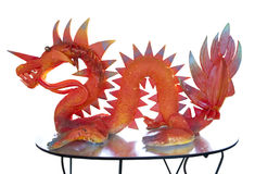 Dragon statue. Statue of a dragon on a table Royalty Free Stock Photo