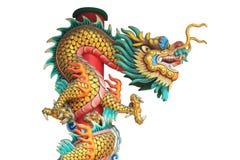Dragon statue around the pole isolated on white background Stock Photos