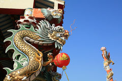 Dragon statue attached on the lamp post Royalty Free Stock Image