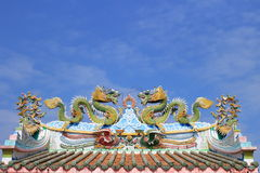 Dragon statue on china temple roof. With tile and sky background royalty free stock photography