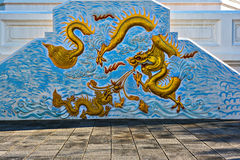 Dragon statue china in the wall temple of blue color Royalty Free Stock Image