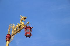 Dragon statue with the chinese red lantern. Close up for dragon statue and the chinese red lantern with sky background stock photo