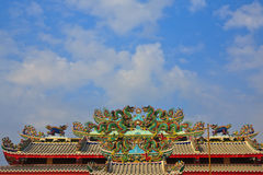 Dragon statue on Chinese style church roof. The statue is a symbol of the Chinese dragon. And cultural heritage is a long time stock photography