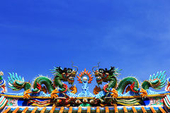 Dragon statue. On Chinese style roof decoration Royalty Free Stock Photos