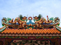 Dragon Statue Chinese temple roof. With blue sky royalty free stock images