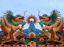 Dragon Statue Chinese temple roof. With blue sky royalty free stock image