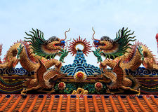 Dragon Statue Chinese temple roof. With blue sky stock photography