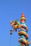 Dragon statue climb the pole. At the china shrine stock photos