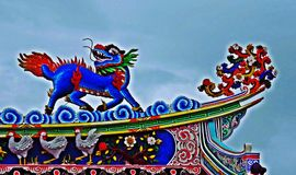 Dragon statue flying Chinese temple roof in Thailand royalty free stock image