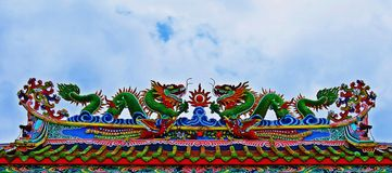 Dragon statue flying Chinese temple roof in Thailand royalty free stock photography