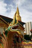 Dragon statue in front of temple Stock Images