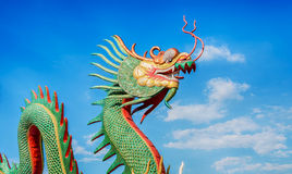 Dragon statue. And natural blue sky background Stock Photos