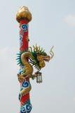 Dragon statue on pillar Stock Photo
