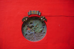 Dragon statue on the red wall in Kuala Lumpur, Malaysia Royalty Free Stock Photography
