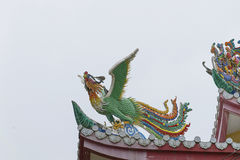 Dragon statue on roof with sky background. Traditional Chinese style art stock photo