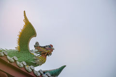 Dragon statue on roof with sky background. Traditional Chinese style art royalty free stock images