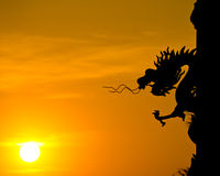 Dragon statue silhouette with sunset. Stock Images