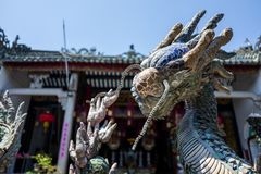 Dragon statue at temlle in Hoi An, Vietnam. stock image