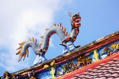 Dragon statue on temple rooftop royalty free stock photo
