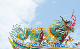 Dragon statue on the top of the roof at chinese temple Royalty Free Stock Image