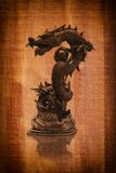 Dragon statue on the wood texture for 2012. Image of Dragon Statue on the vintage wood texture background Stock Photos
