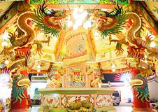 Dragon statues around the stone pillars adorned with bright lights in Chinese temples. Dragon statues around the pillars adorned with bright lights in Chinese Stock Image