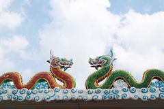 Dragon statues in Chinese style on roof Royalty Free Stock Photos