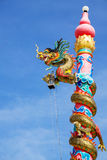 The Dragon status Chinese style. With nice blue sky Royalty Free Stock Photo