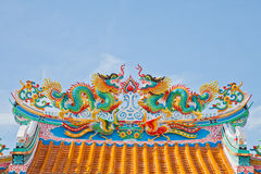 The Dragon status on roof of joss house Stock Image