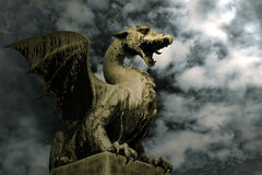 Dragon in stone. Dragon on the stone over dramatic sky. Symbol of Ljubljana Stock Photography