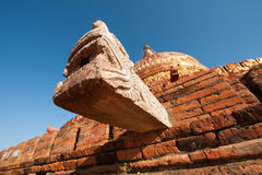 Damayzaka Pagoda in Bagan, Myanmar. Dragon style water drainage pipe on the Damayzaka Pagoda in Bagan, Myanmar Royalty Free Stock Photos