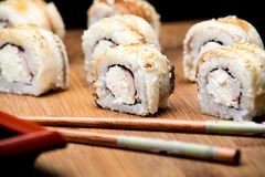 Dragon sushi roll with eel and cream cheese. Stock Photography